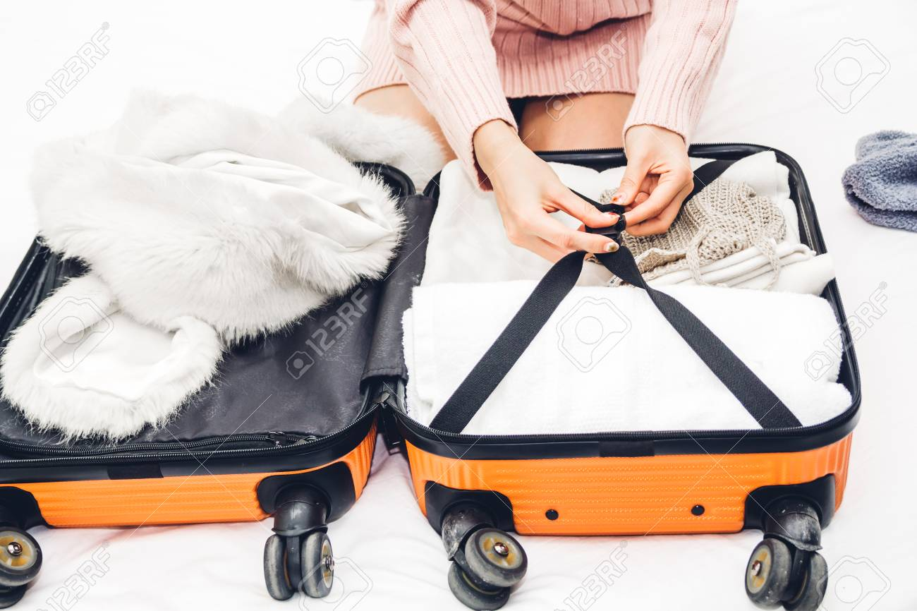 949bb3ca73 Stock Photo - Woman packing a suitcase luggage and backpack for travel at  home.Holiday vacation concept