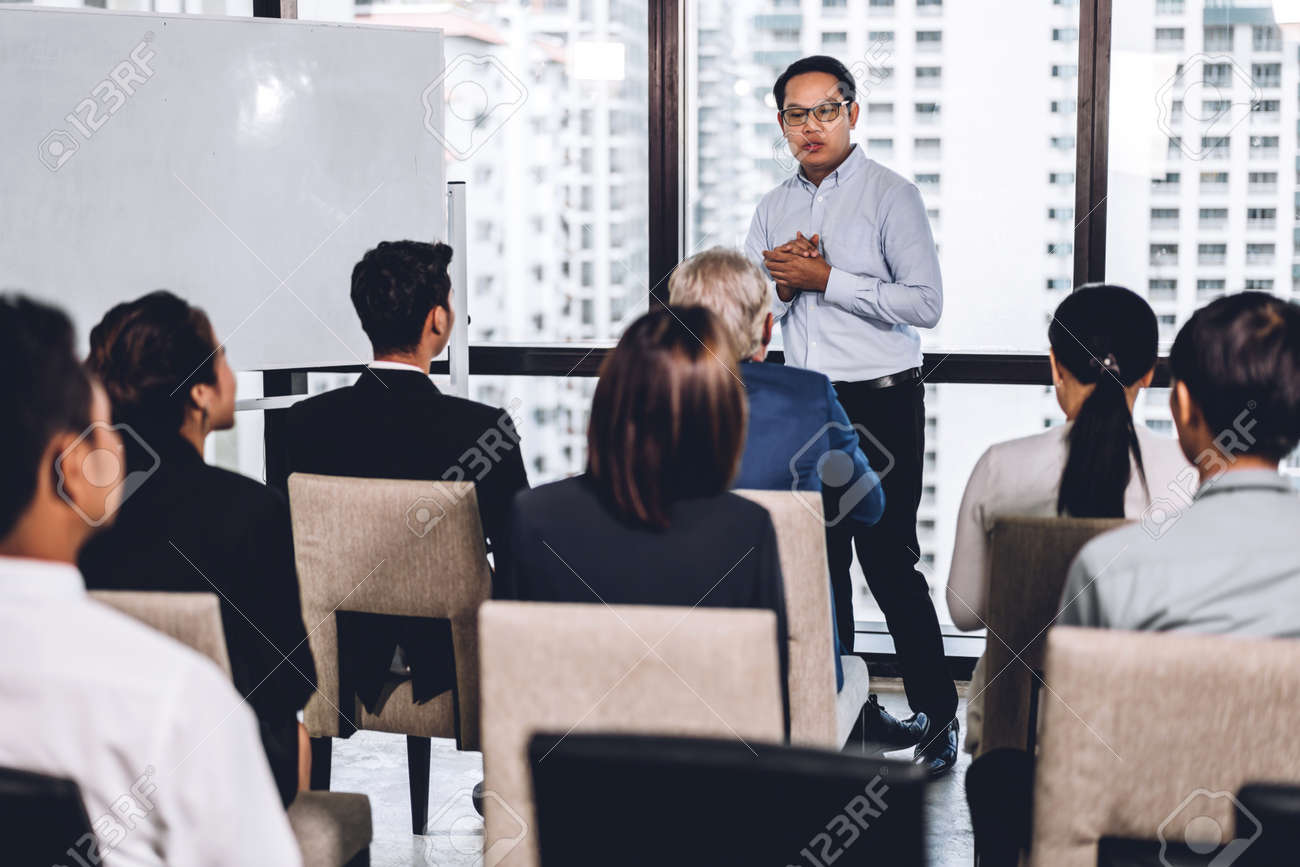 Businessman standing in front of group of people in consulting meeting conference seminar at hall or seminar room.presentation and coaching concept - 155777459
