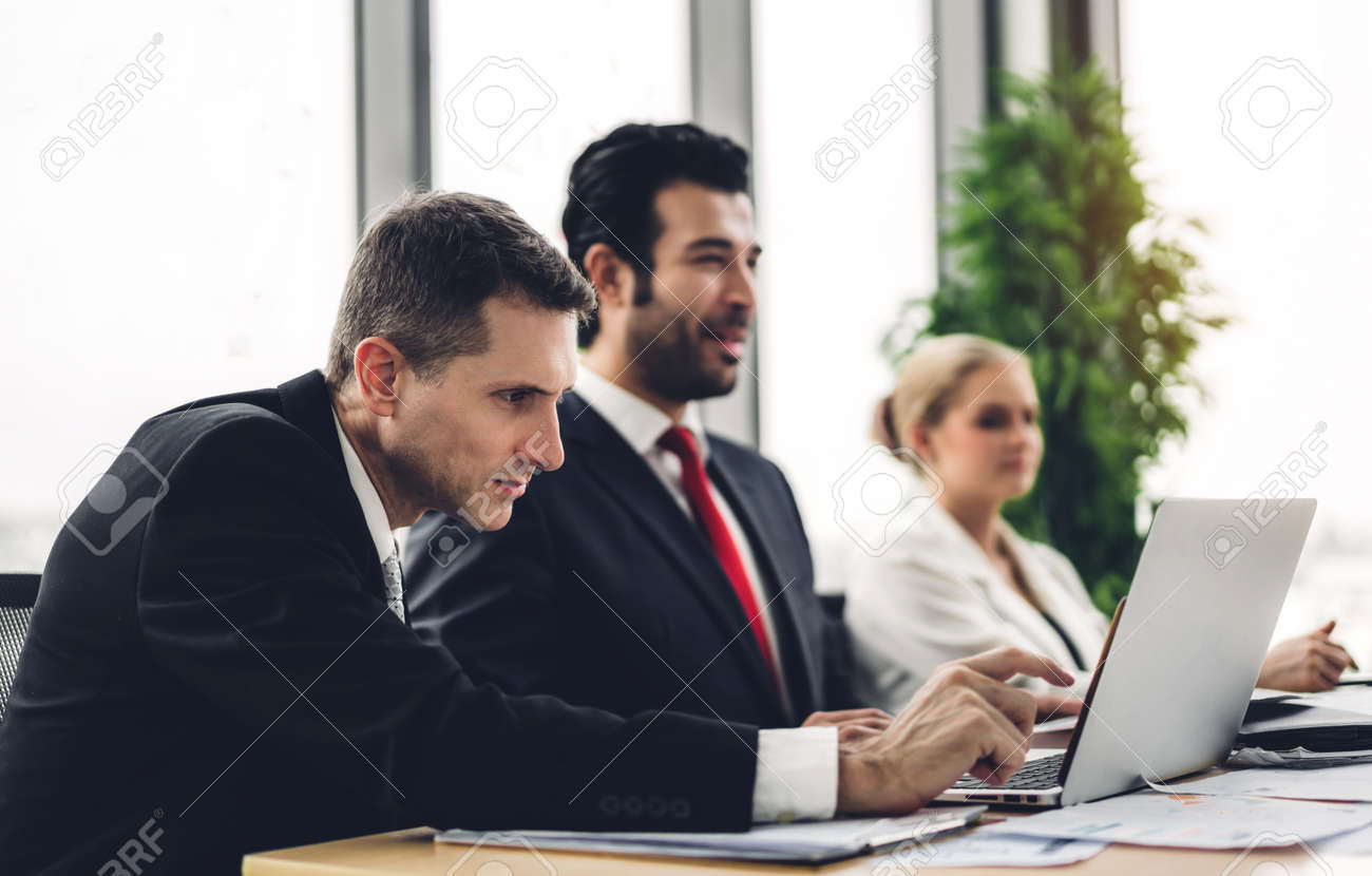 Group of professional business meeting and discussing strategy with new startup project on laptop computer.Creative business people management planning and brainstorm with document report in modern workloft.Teamwork concept - 168606984