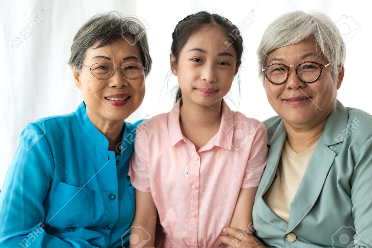 Portrait of happy asian grandmother and little cute girl enjoy relax together look at camera.Family and togetherness - 168607006