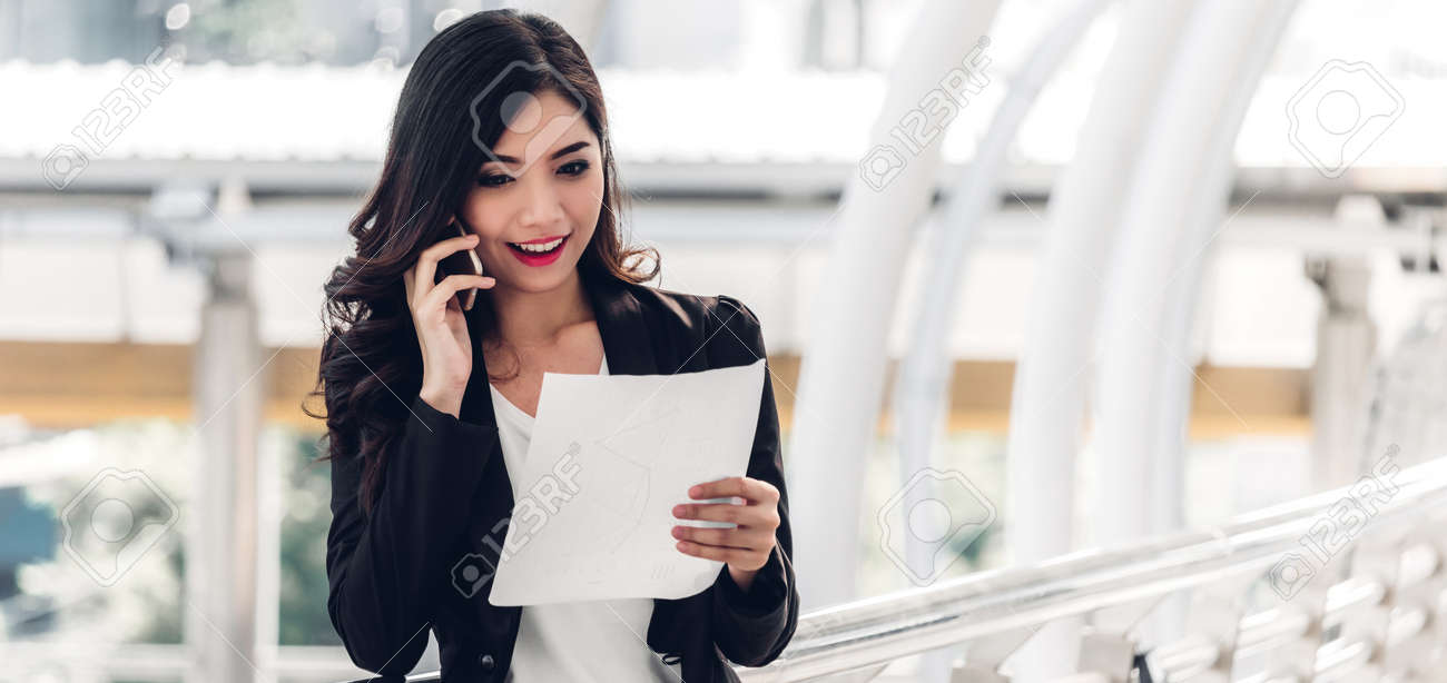 Businesswoman using smartphone.creative business people planning and working on city - 168607134