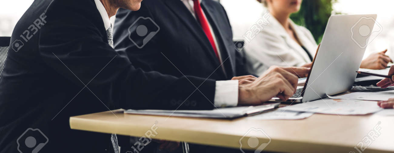 Group of professional business meeting and discussing strategy with new startup project on laptop computer.Creative business people management planning and brainstorm with document report in modern workloft.Teamwork concept - 168607236
