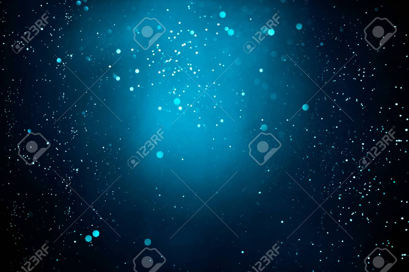Abstract dark background with glowing turquoise particles. - 144725798