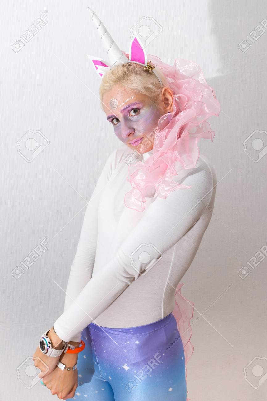 pink cute sexy girl unicorn on white background young woman close up portrait halloween