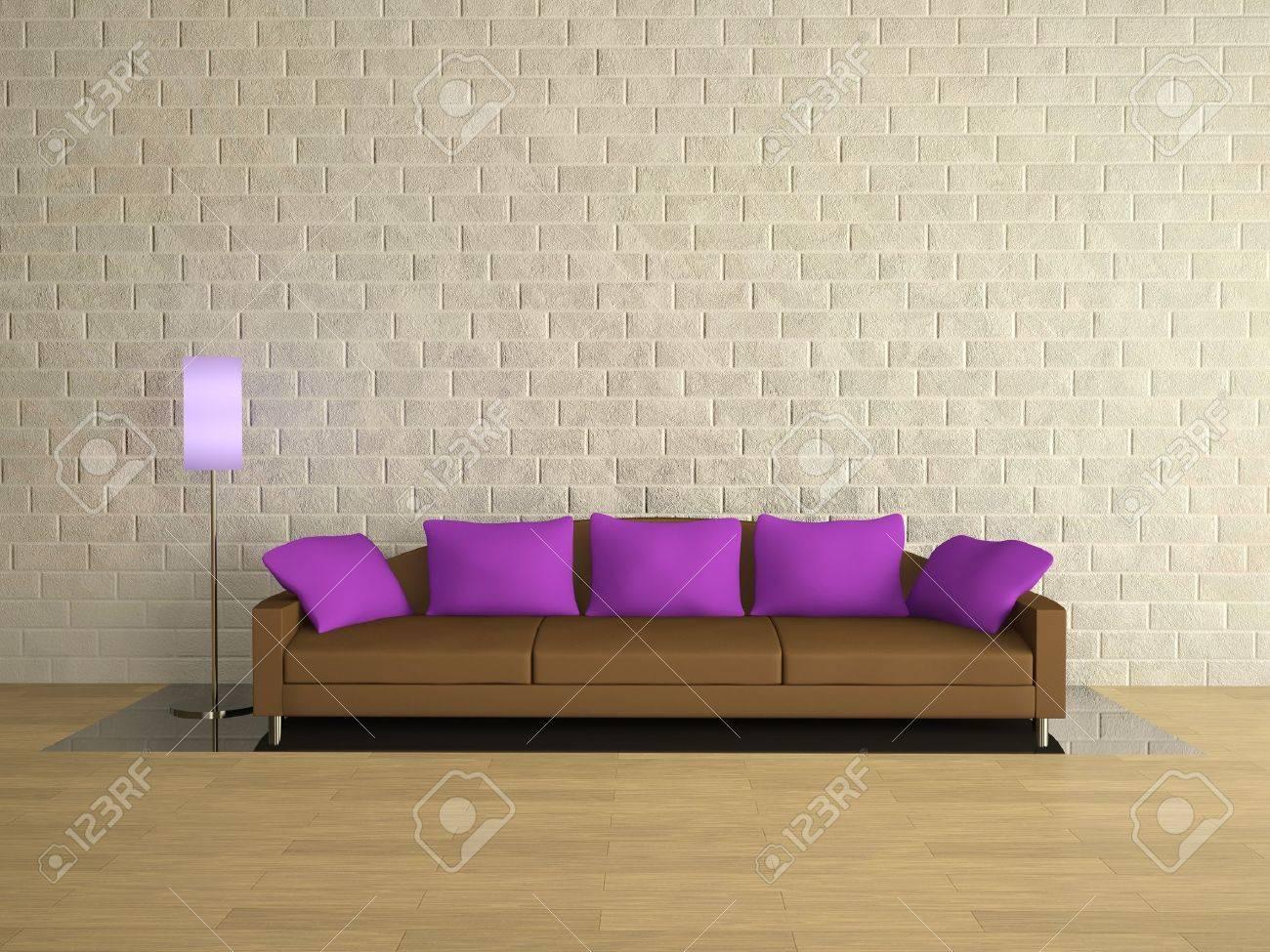 Brown Sofa With Lilac Pillows Near A Brick Wall Stock Photo ...