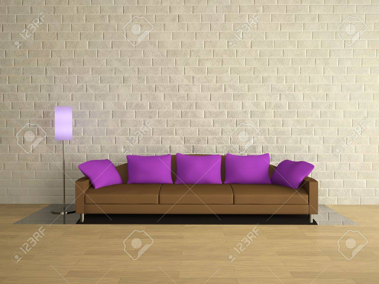 Brown sofa with lilac pillows near a brick wall Stock Photo - 12910988
