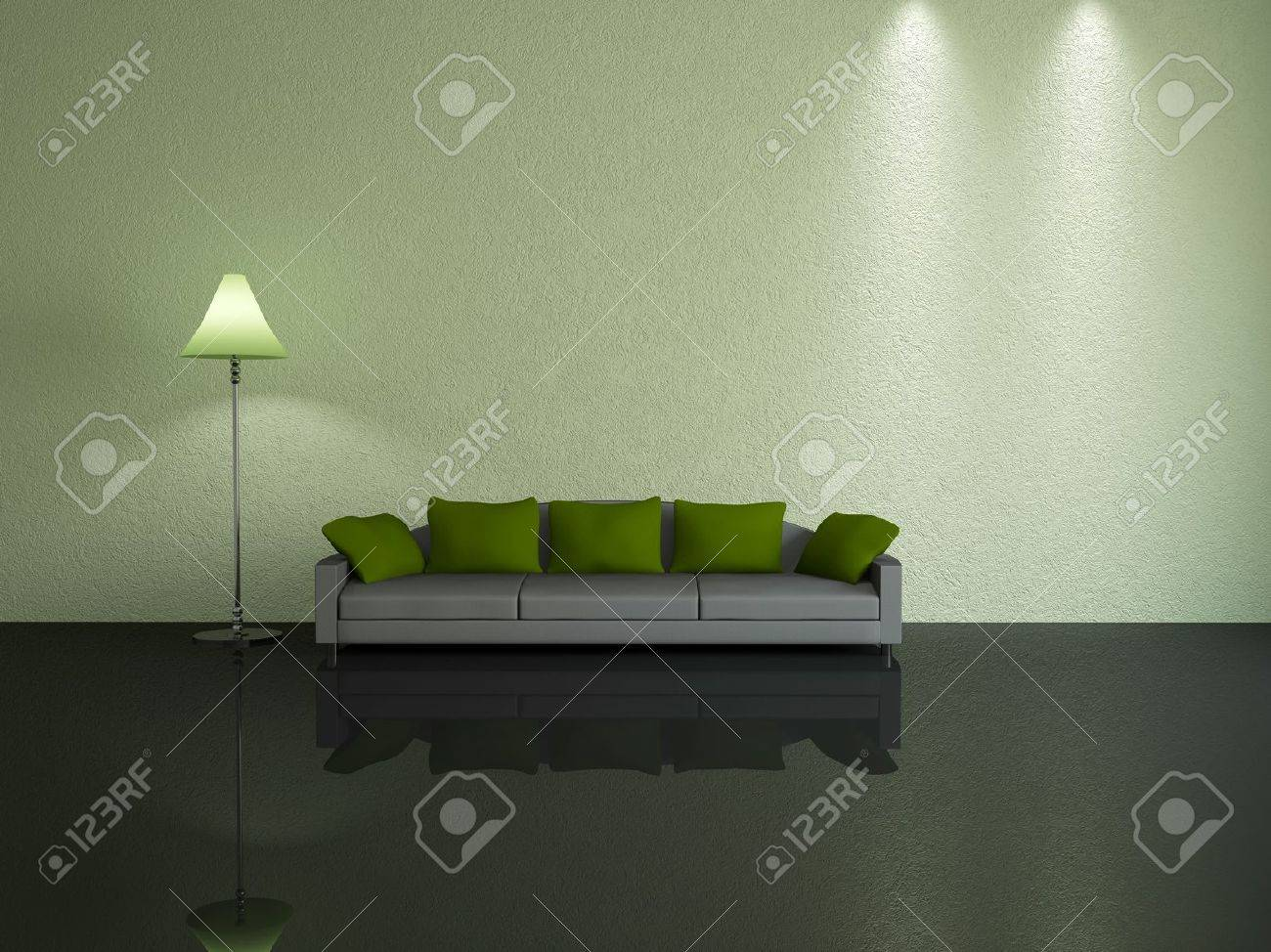 Grey Sofa With Green Pillows Near A Wall Stock Photo Picture And