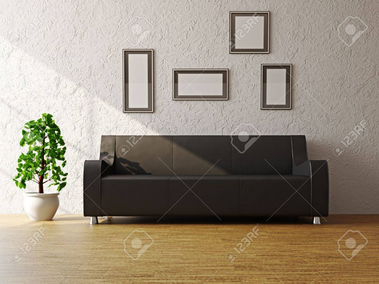 Black leather sofa and a plant near the wall