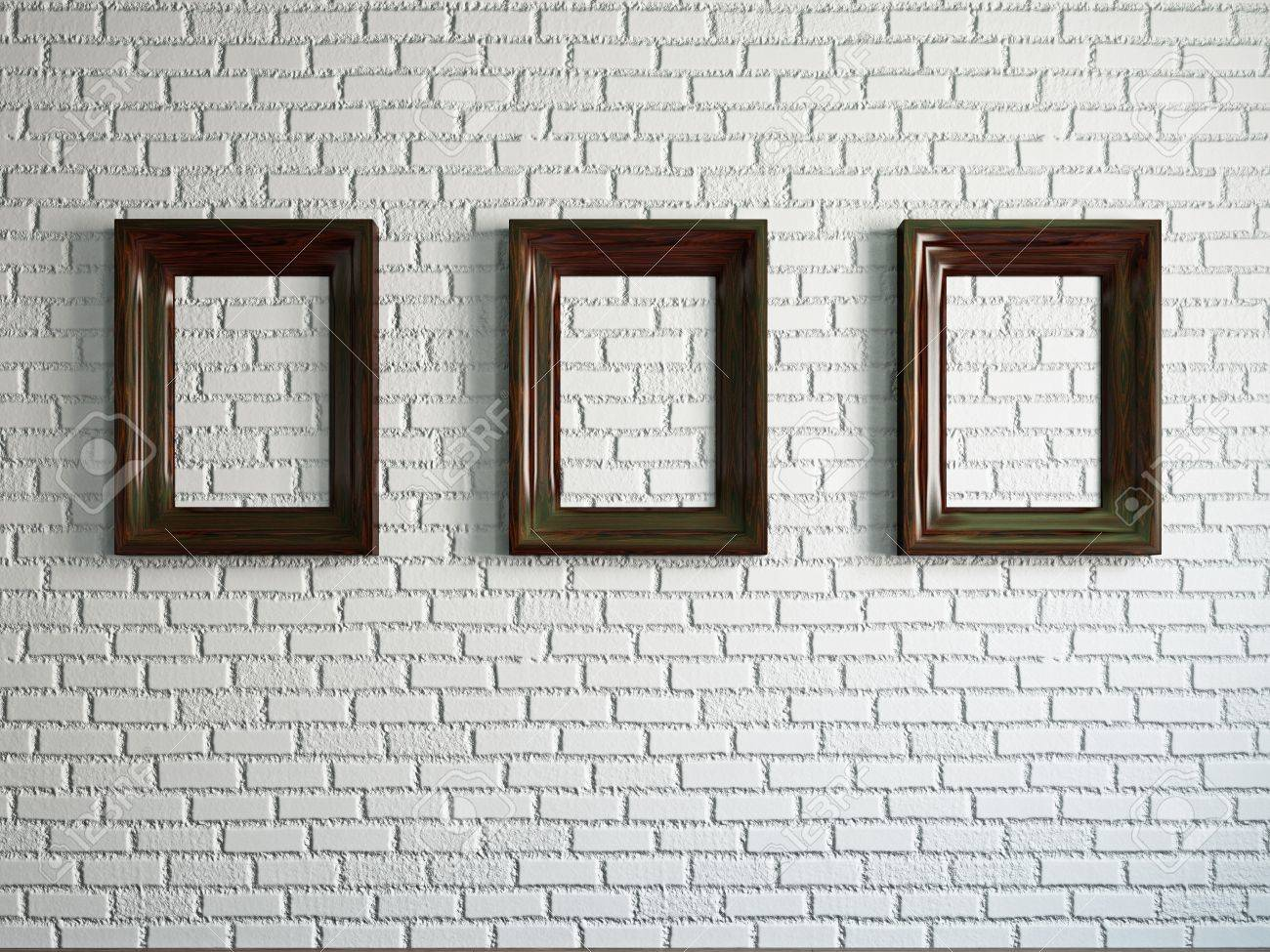 stock photo three empty wooden frames on the brick wall