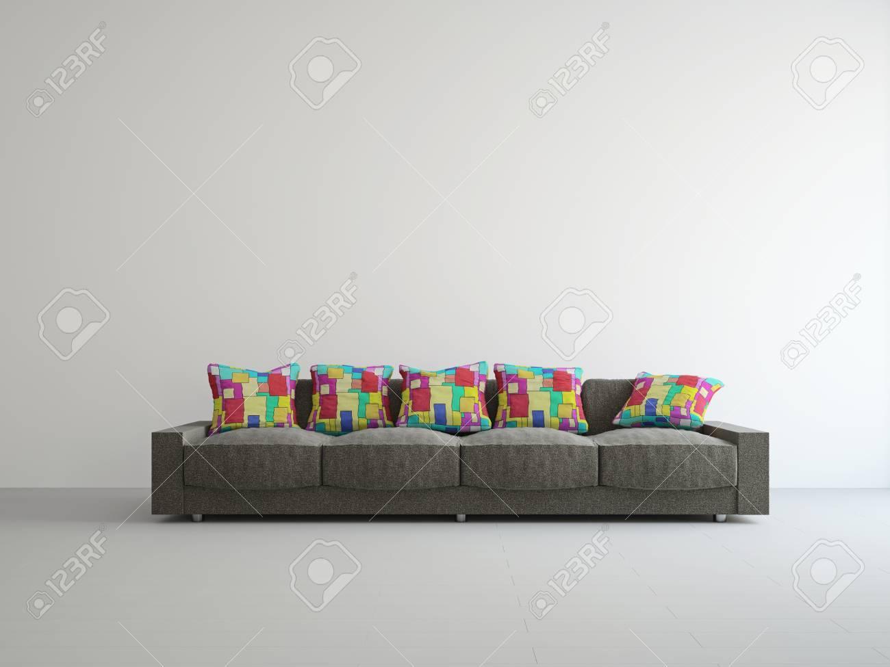 Cuscini Divano Colorati.Divano Marrone Con Cuscini Colorati Vicino Al Muro