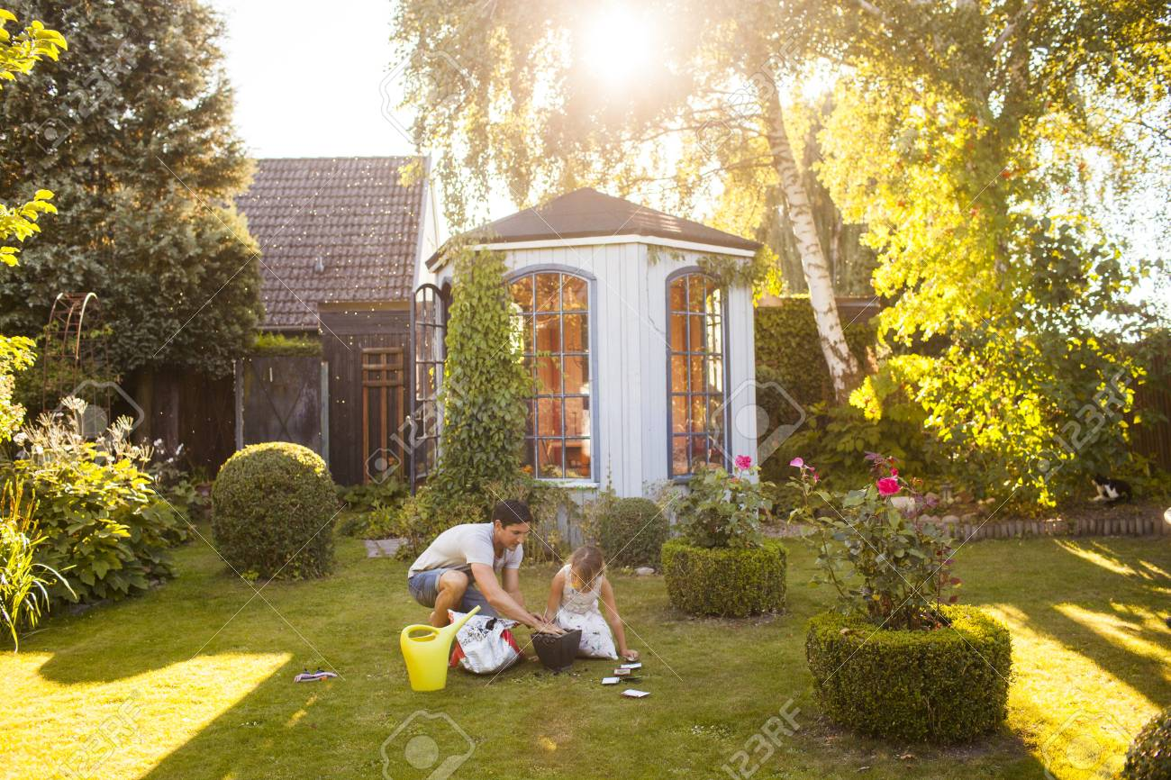 Father With Daughter Gardening In Backyard Stock Photo, Picture And ...