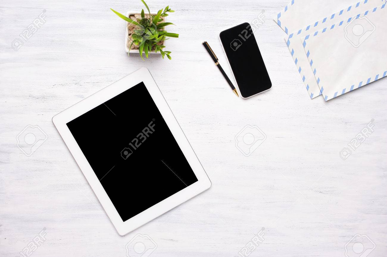 home office items. Stock Photo - Top View Of A Tablet Computer, Smartphone And Office Items On White Wooden Desk. Home Concept. Business Lifestyle. Copyspace.