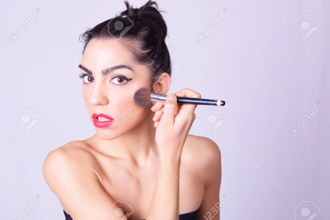 Closeup Of Young Beautiful Woman Applying Foundation Powder Or Stock Photo Picture And Royalty Free Image Image 62718921