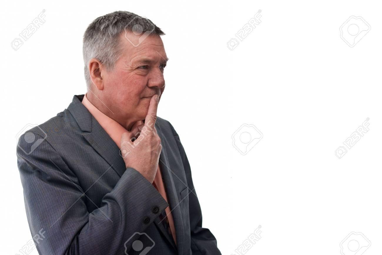 portrait of a senior businessman 3 4 view with finger on mough