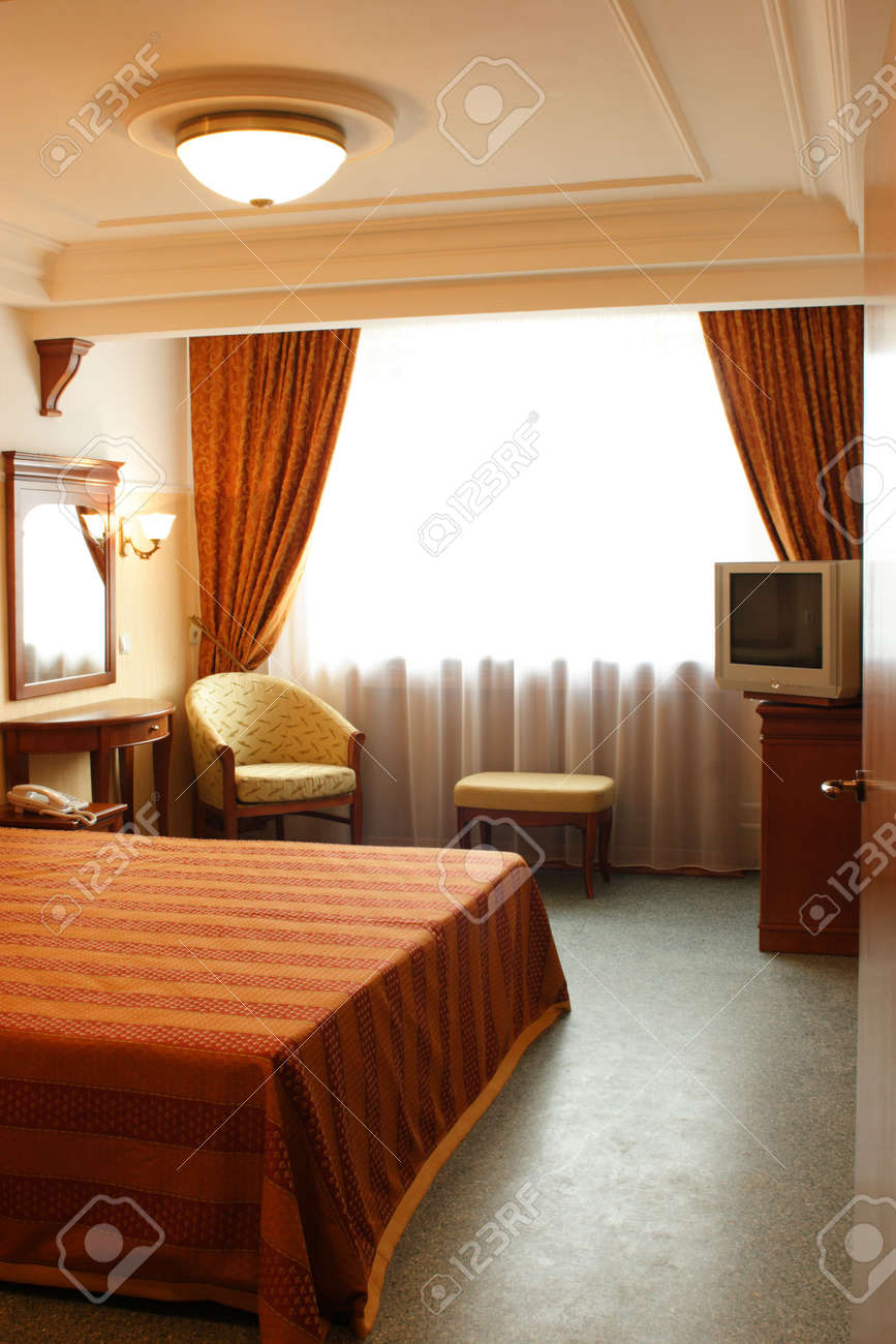 Interior, Bedroom in Red Color with Mirror and TV Stock Photo - 2669104