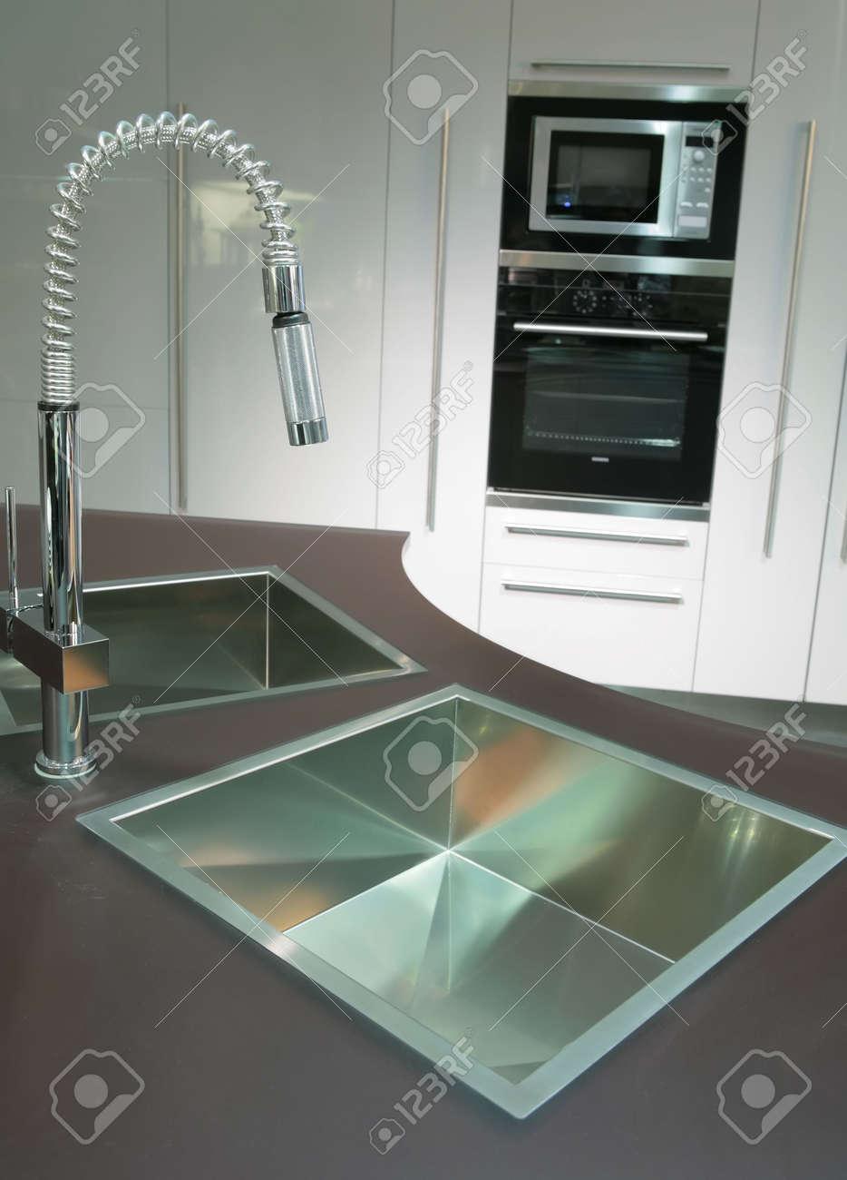 modern metallic sink with graceful tap on the super-modern kitchen Stock Photo - 3001822