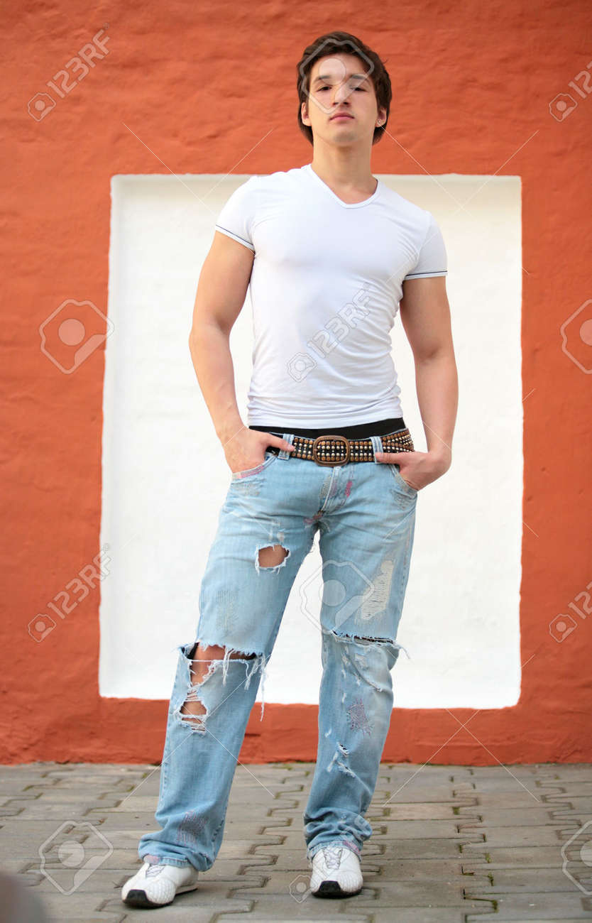 White t shirt and blue jeans - White T Shirt Blue Jeans Stock Photo Portrait Of The Young Man In White T