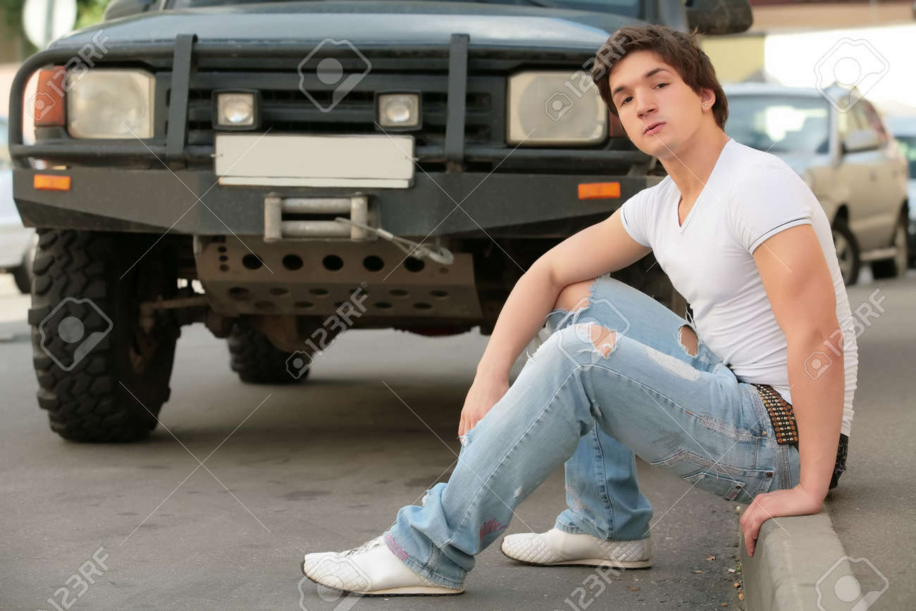 White t shirt and blue jeans - Stock Photo Man In White T Shirt And Blue Jeans
