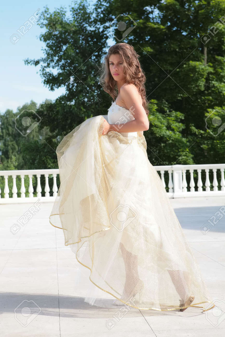 Beautiful Girl In Wedding Gown On Background Of The Snow-white ...