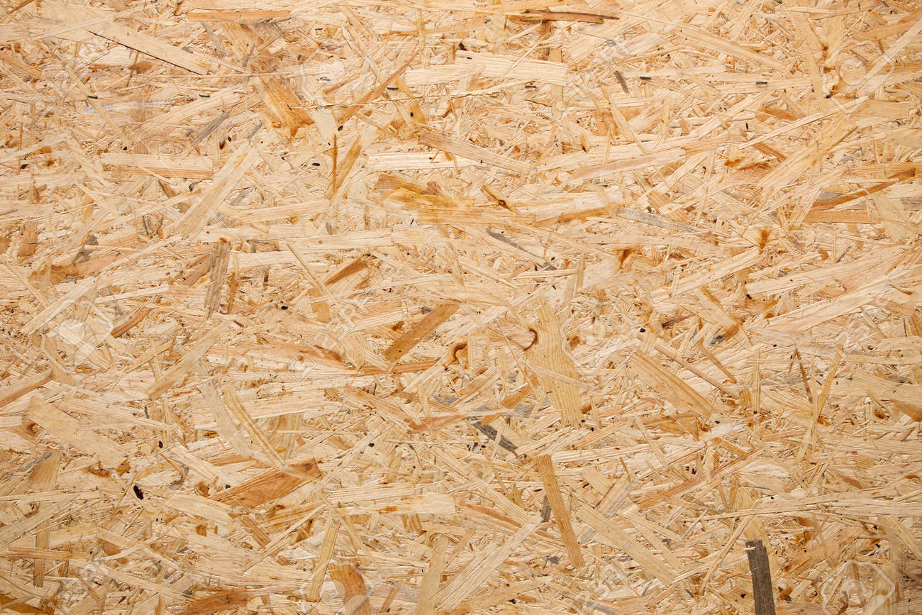 yellow wood chipboard can be used as a background stock photo