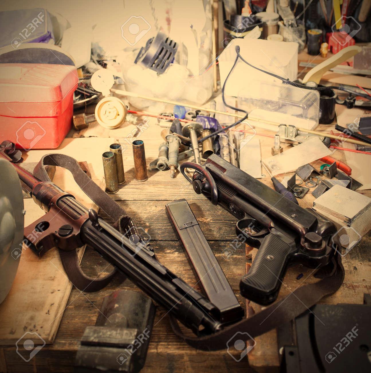MP38 sub machine gun on the table master restorer in the interior