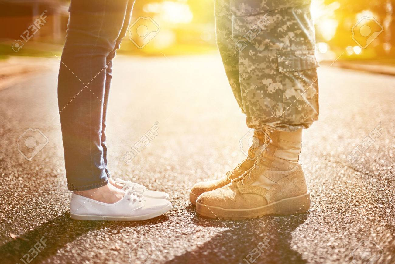 Young military couple kissing each other, homecoming concept, soft focus,warm orange toning applied - 51287363