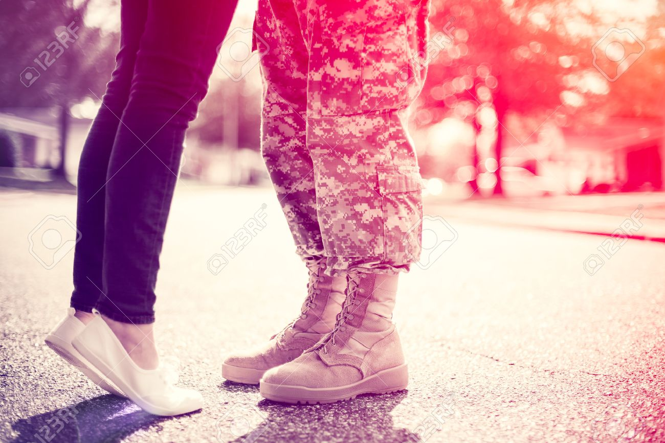 Young military couple kissing each other, homecoming concept, soft focus, cross process toning applied, light leak in the corner - 53124723