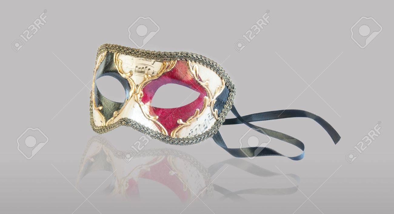 Venetian carnival mask isolated on grey background Stock Photo - 17510825