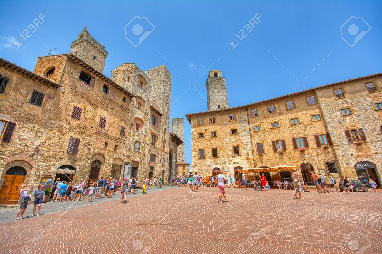 San Gimignano, Italy - July 3, 2018: Panoramic view of famous Piazza della Cisterna in the historic town of San Gimignano on a sunny day, Tuscany, Italy - 133173044