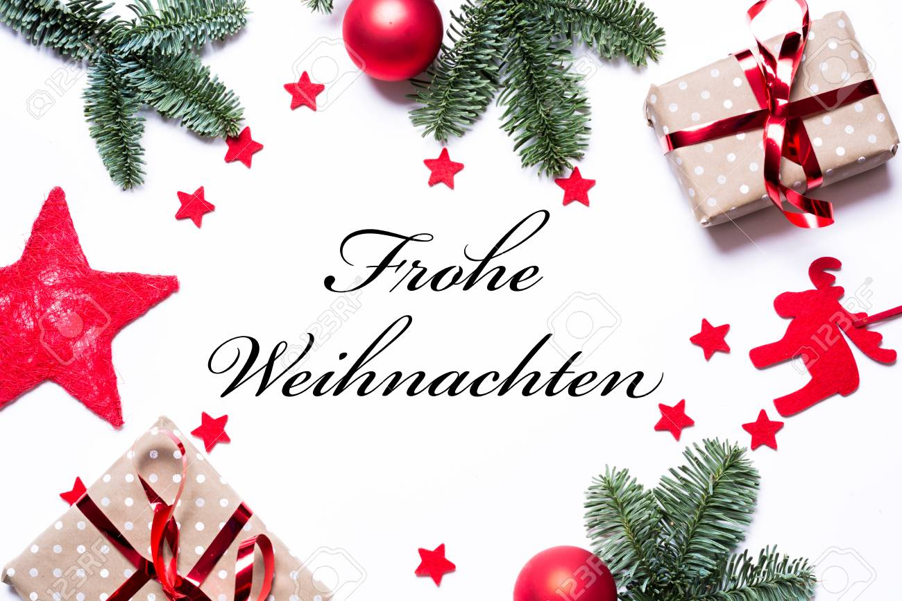 The Text Merry Christmas In German On A Christmas Background With ...