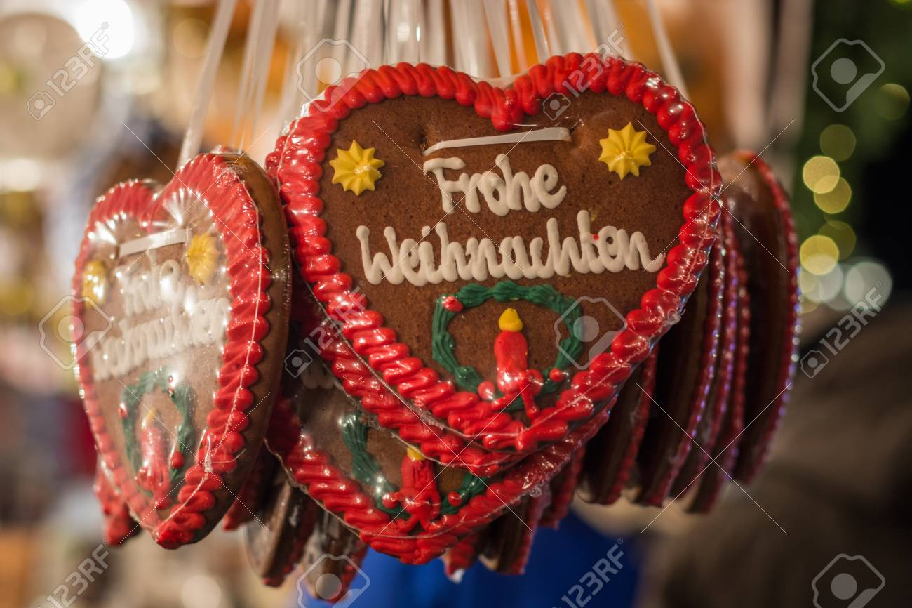 Several Gingerbread Hearts With Merry Christmas In German At