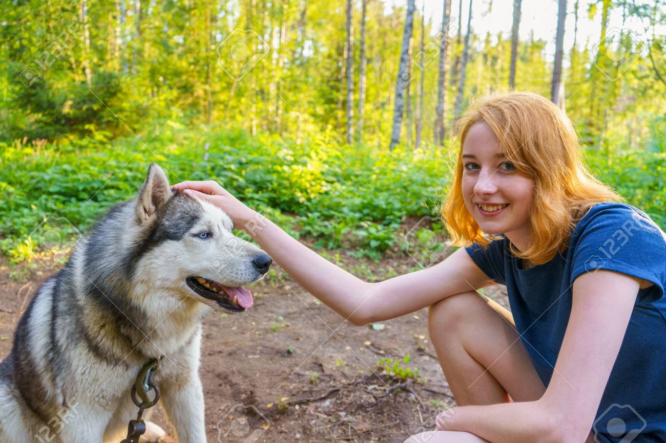 Beautiful Young Lady With Her Adorable Cute Dog Of Siberian Hasky Stock Photo Picture And Royalty Free Image Image 112630994