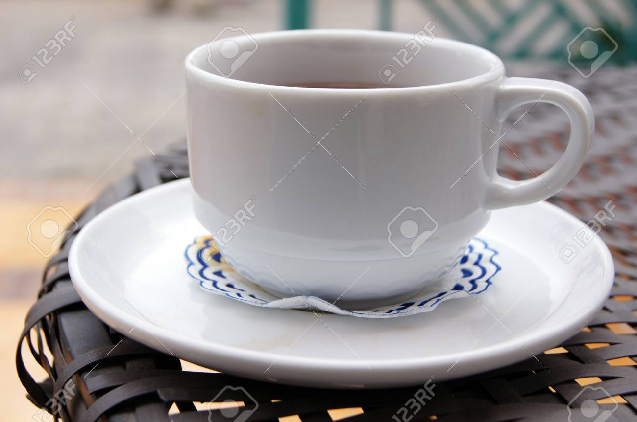 Cup of coffee on the table with reflexion Stock Photo - 12820350