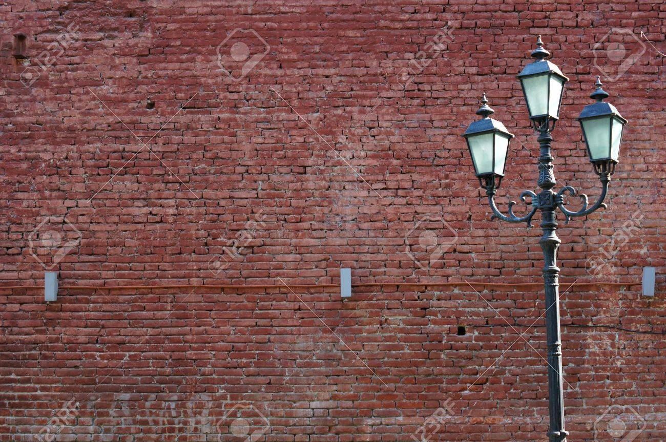 red brick old wall and city lamp Stock Photo - 13561744