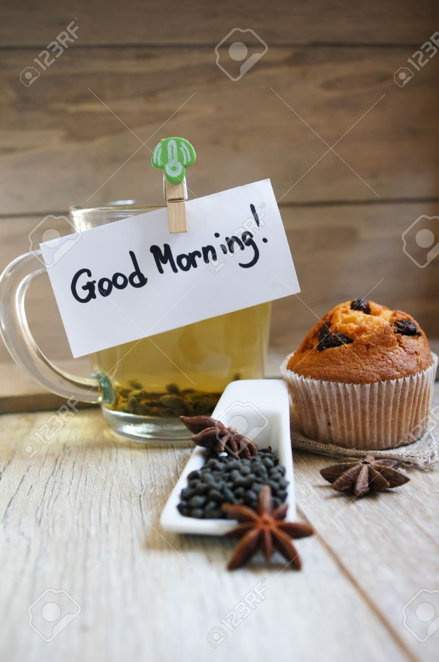 Cup Of Hot Green Tea Cupcakes And Good Morning Note On The Wooden Stock Photo Picture And Royalty Free Image Image 32058668