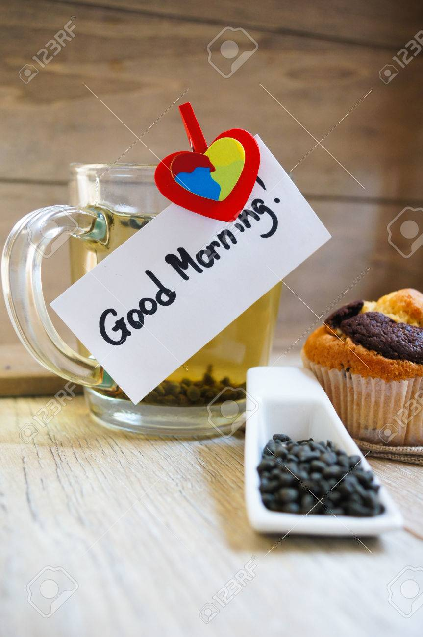 Cup Of Hot Green Tea Cupcakes And Good Morning Note On The Wooden Stock Photo Picture And Royalty Free Image Image 32058691