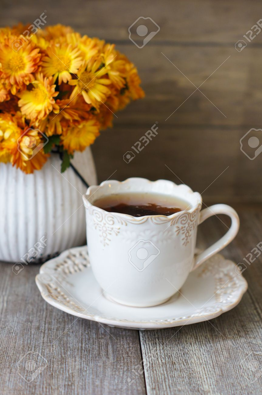 Cup Of Tea Autumnal Flowers And Good Morning Note Stock Photo