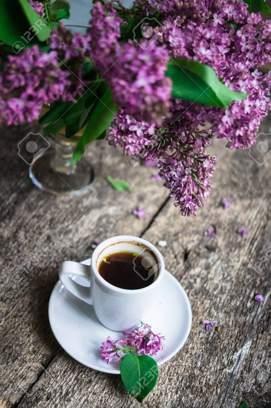 Lilac Flowers In A Vase And Cup Of Coffee On The Rustic Style Stock Photo Picture And Royalty Free Image Image 38588337