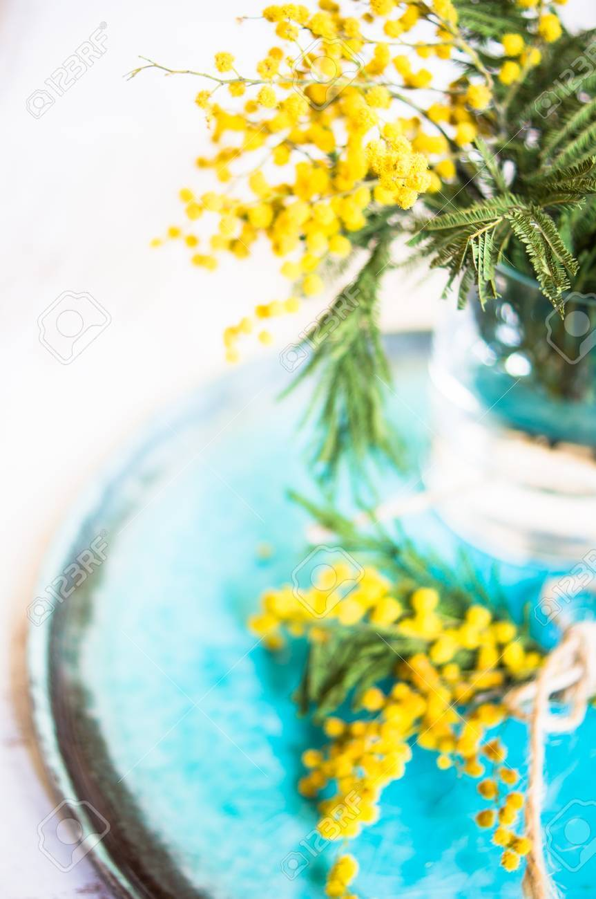 Spring Time Table Decoration With Yellow Mimosa Flowers And