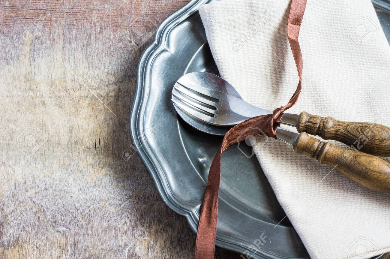 Rustic Table Setting With Bright Napkin, Silverware And Plate ...