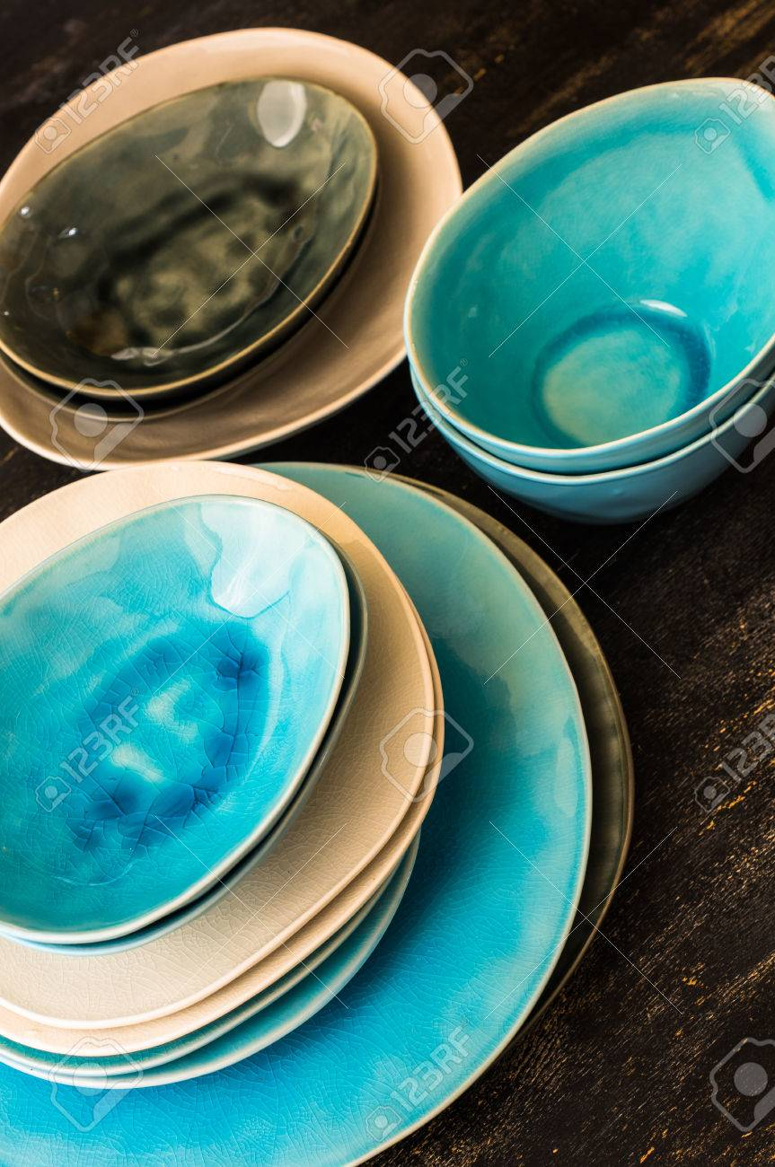 Ceramic rustic tableware in blue and grey colors on dark wooden background Stock Photo - 66580906 & Ceramic Rustic Tableware In Blue And Grey Colors On Dark Wooden ...