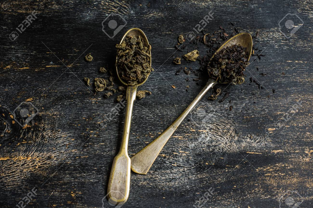 Different Types Of Green Tea In Vintage Spoons On Dark Wooden