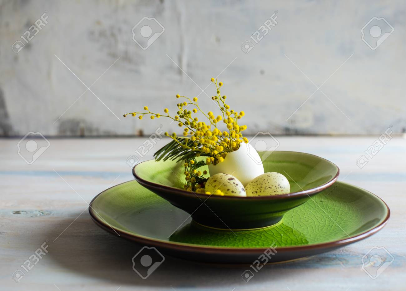 Stock Photo - Table setting for Easter dinner with blooming mimosa acacia flowers and eggs on bright green plates & Table Setting For Easter Dinner With Blooming Mimosa Acacia Flowers ...