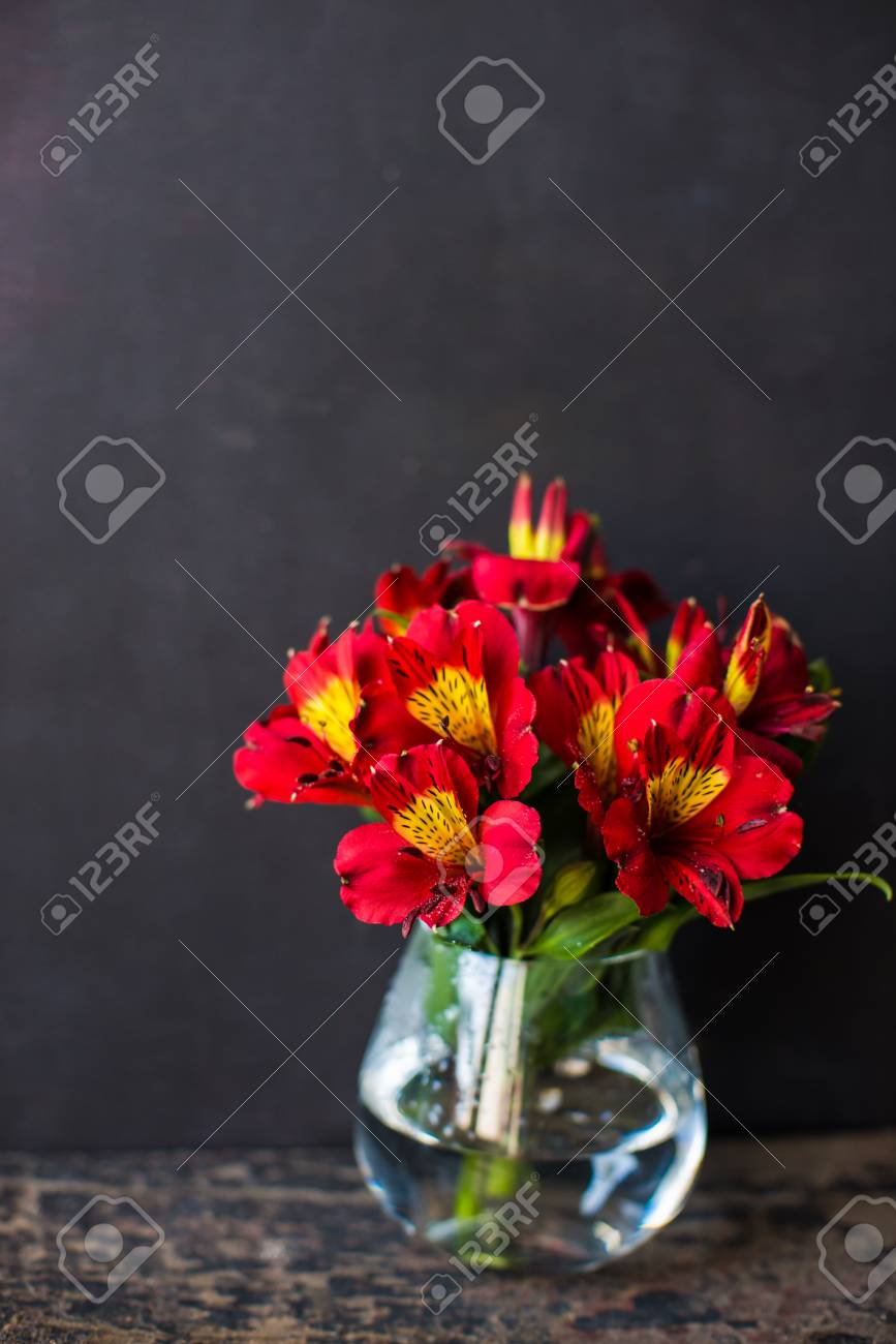 Red lily flowers with red ribbon on dark wooden table stock photo red lily flowers with red ribbon on dark wooden table stock photo 75104867 izmirmasajfo