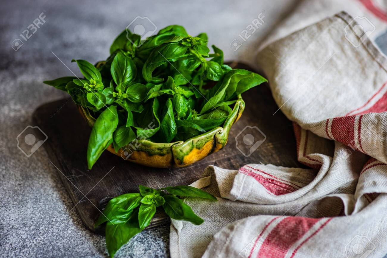 Healthy food concept with fresh basil herb leaves in a bowl - 124030145