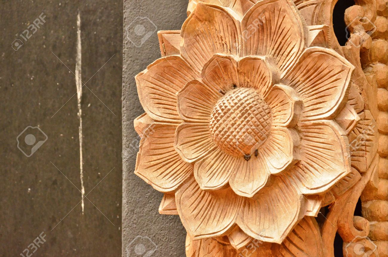 High relief sculpture of wood flower stock photo picture and