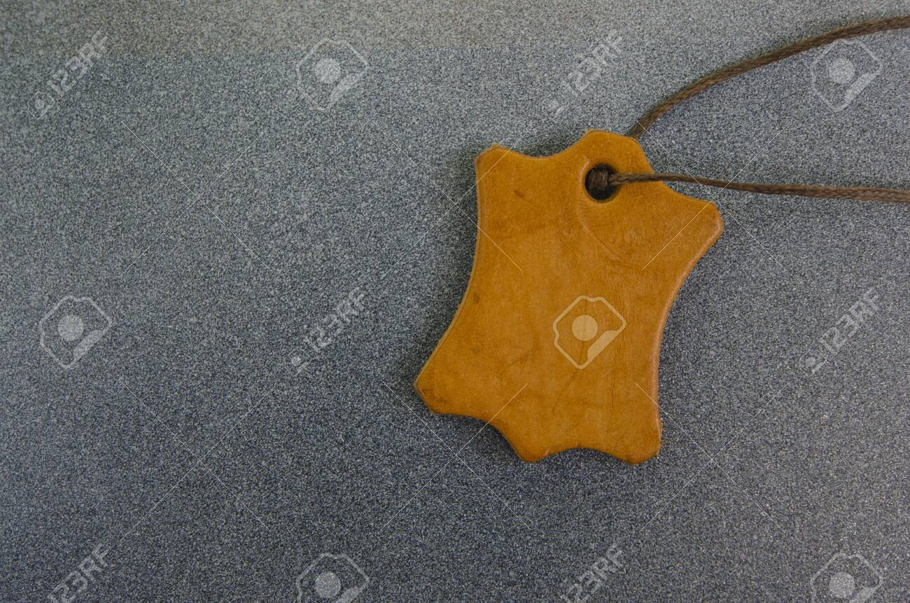 Blank brown leather sign with rope - 130457301