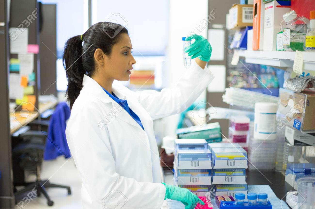 Closeup Portrait, Young Scientist In White Lab Coat Doing ...