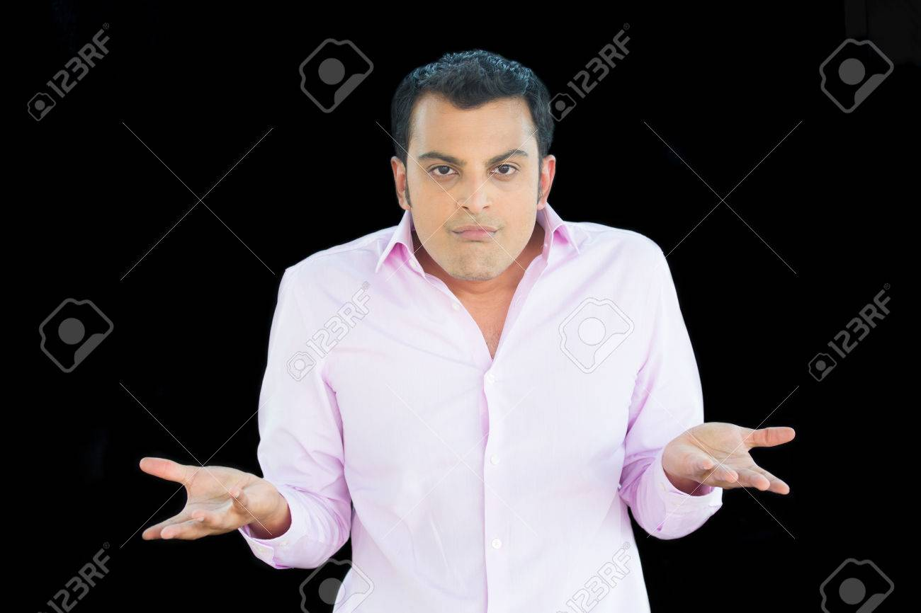 a85ce967 Closeup portrait of angry unhappy young man in pink shirt arms out asking  whats the problem