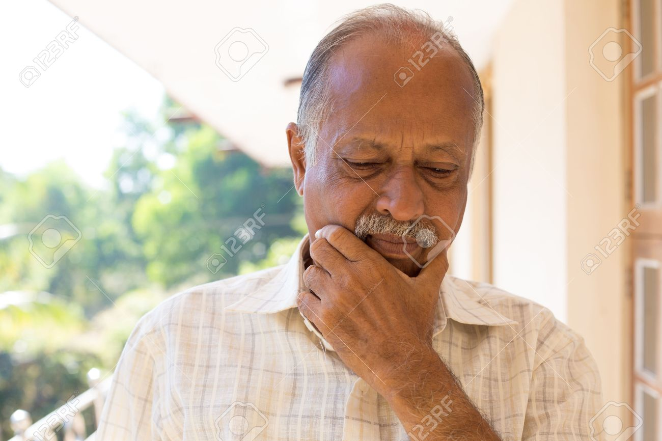 Closeup portrait, morose elderly pensioner, downcast gloomy, isolated outside outdoors home background - 60059611